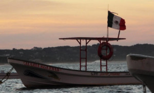 mexico flag fishing boat puerto escondido
